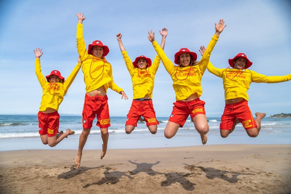 Picture of New Zealand Surf Lifesavers jumping in the air